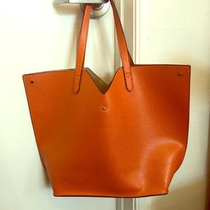 Neiman Marcus orange tassel fringe tote bag